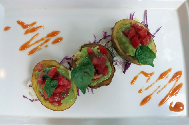 "Potato Skins - a fantastic take on a ""pub"" classic.  Lovely Mexican style Guacamole and Salsa on top.  Very tasty."
