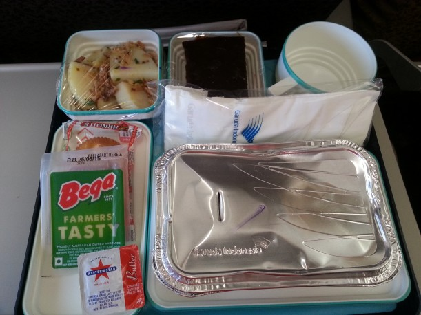 Garuda Inflight Meal service was quite good.  Lunch was a Chicken Curry, with a potato salad, cheese & crackers, with a chocolate cake for dessert. Who needs that much for lunch?