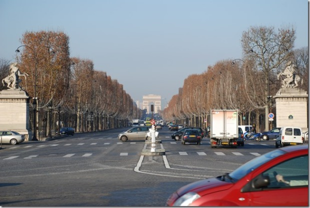 The Arc de Triomphe stands impressively from the bottom of the Champs-Elysees.