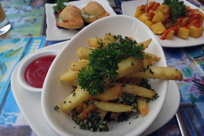 Garlic-Parsley Fries - Hand-cut French Fries tossed with finely chopped garlic and fresh parsley