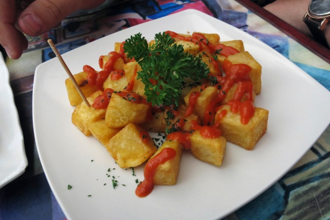 Papas Bravas - Sautéed Potatoes topped with spicy paprika mayo sauce