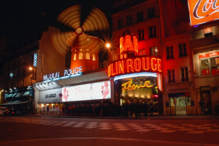 The Moulin Rouge comes alive at night, when the neon lights are in full swing.