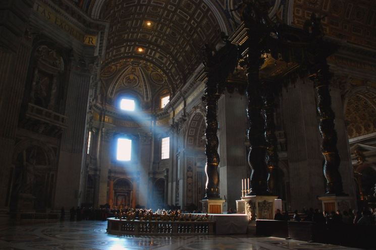 Beams of light shining into the spectacular St. Peter's Basilica, Vatican City.  Despite the crowds of tourists and pilgrims this basilica evokes a calm serene environment.