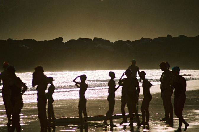 Delving way back in my travel photography archives this was from February 2002 on a week away in Noosa Heads, Queensland.  This great shot of the local lifesavers preparing for their morning swim.  Little bit of cloud brought the colour.  Ah the days of shooting Film.