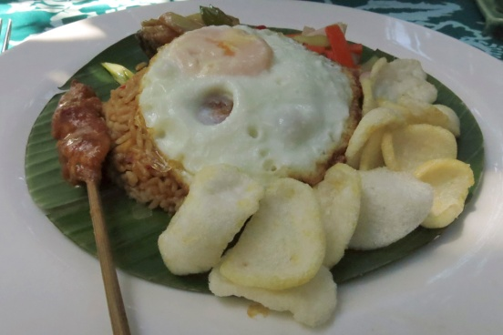 Nasi Goreng with a nice Satay Ayam (Chicken).  Tasty, well cooked Nasi.  Just the right balance of flavours.