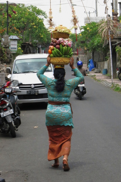 Exploring the streets of Ubud, around the area of Chez Monique.  Amazing balance skills and neck muscles on this woman, walking her offering to the temple.