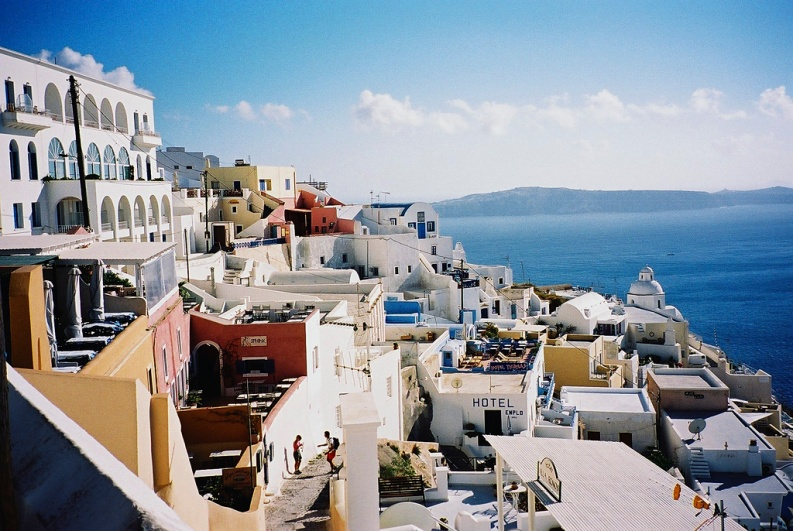 The deep azure skies above Santorini, contrasting the stark white and neutral colour pallet of the houses adorning the coastlines.