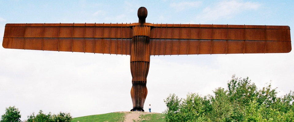 It is hard to describe to people the size of the Angel of the North in Gateshead, England.  So including a human element can help to give some perspective to the image.