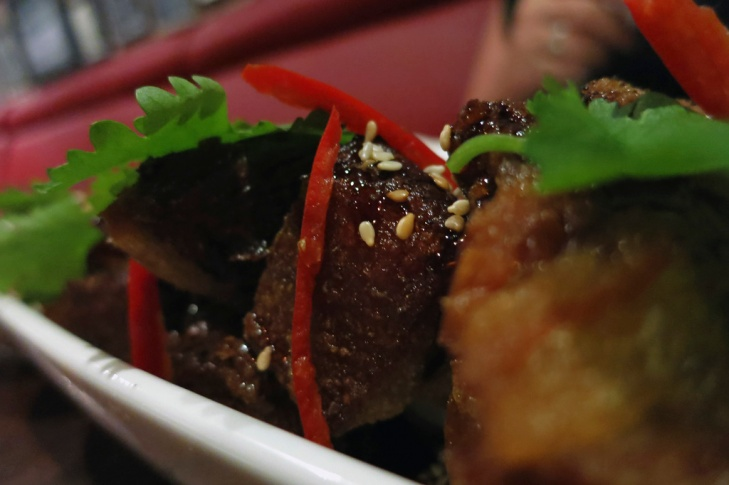Our entrée of Twice Cooked Crispy Pork Belly, served with Caramel reduction, chilli vinegar and coriander (Rp. 55k)