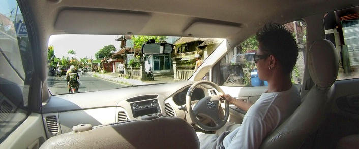 "Fredy in his ""office"" I swear he knows every secret road in Bali - every shortcut and special parking spot!"